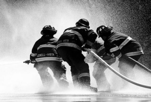 Image Showing Several Firemen Controlling The Water Hoses.