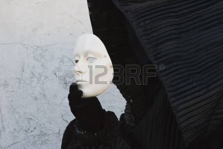 Featured Imaged Showing A White Mask Being Removed/Put On By A Black Cloaked And Gloved Figure.