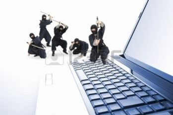 Featured Image Of Many Mini Ninjas Posed On A Computer/Keyboard.