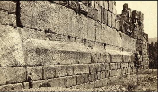 PART OF THE BAALBEK WALL COMPLEX. THE LARGE STONES SEATED HORIZONTALLY ARE TERMED TRILOTHON. THE FIGURE IN BOTTOM LEFT CORNER IS A MAN FOR SIZE COMPARISON. THE TRILOTHON... WE COULD POUR-MOLD PERHAPS ON SITE... USE WATER TO RAISE TO HEIGHT.?... HOWEVER THESE ONES WERE QUARRIED...NEARBY...SEE PIC BELOW... AND... MOVED AND LAID SOMEHOW.?. photocredit/thanks:hiddenincatours