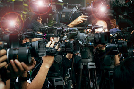 Featured Image Of Many Cameras At A Press Conference.
