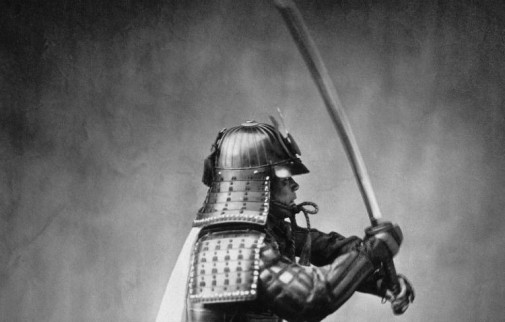 Image Of A Japanese Samurai Armored With Sword Raised.
