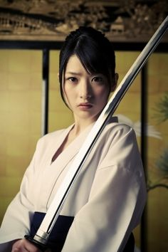 SWORD HOLDER KUNOICHI... CLICK PHOTO TO SEE A SWORD SMASHING LEGEND INDEED.