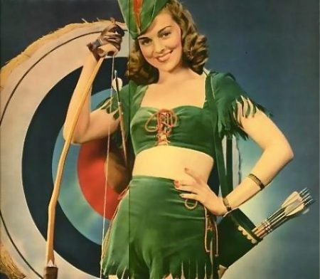 Image Of A Female Robin Hood Standing In Front Of A Target.
