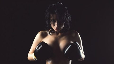Image Of A Semi Naked Female Boxer Gloved Hands Strategically Placed.