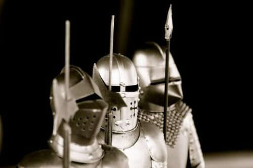 Featured Image Highlighting Uppers Torso Of Three Knight Armor Suits And Spears.