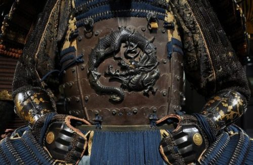 CATS-EYE CLOSE-UP VIEW OF A SAMURAI's COAT OF ARMS...PER SE... ON HIS... BELLY IT SEEMS INDEED AND IN FACT.