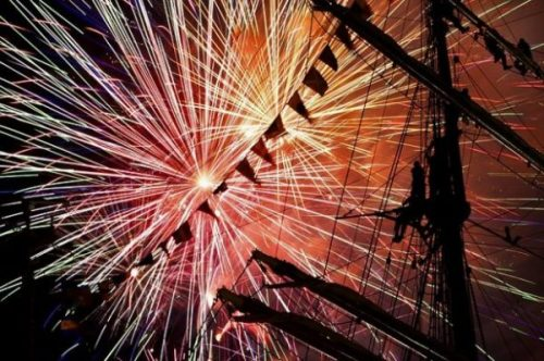 Featured Image Of Fireworks Above A Sailing Ship's Mast.