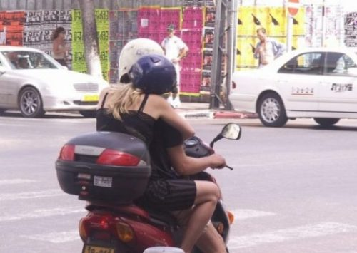 Featured Image Of A Scooter Motorcycle With Two Riders Thereupon.
