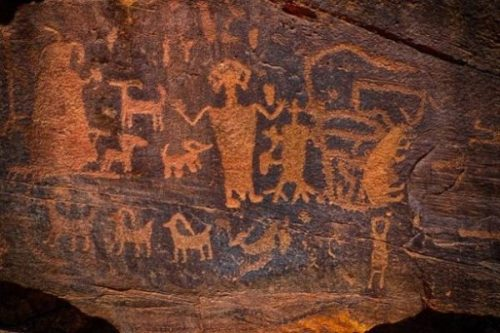 native american usa anasazi ROCK ART... ON RIGHT OF CENTRAL FIGURE... THE THREE TOED AND FINGERED... BEING.?.