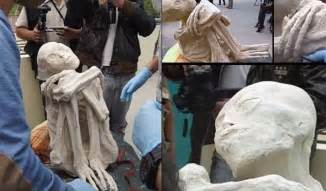 A PHOTO-SET OF ONE OF THE RECENTLY FOUND WHITE POWDER MUMMIES OF NAZCA,.. PERU. photocredit/thanks:mundomisterioso