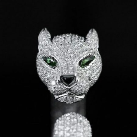 Featured Topic A Dog Figure Encrusted With Jewels Including Large Green Gems For Eyes.