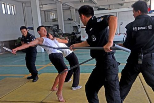 Featured Image Of Police Officers Training With Non Lethal Weaponry Types.