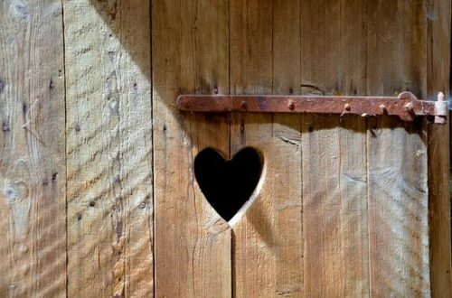 Image Closeup Of A Door With Heart Carved Through.