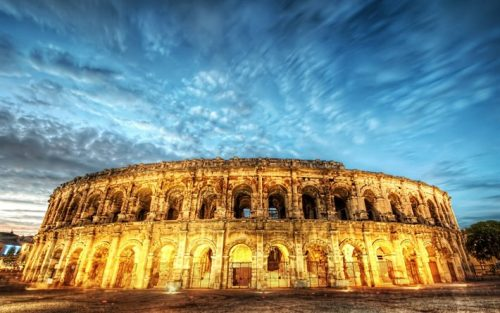 Image Of The Roman Colosseum Brightly Lit.