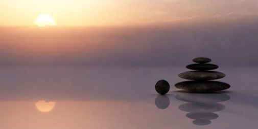 Image Of Zen Stonepile Amidst A Colorful Sunrise.