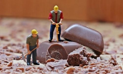 Featured Image Of Toy Workman Quarrying Chocolate Bits.