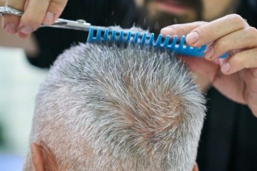 Featured Image Elderly Man Getting a Hair Cut. Close Up On Head, Scissors and Comb.