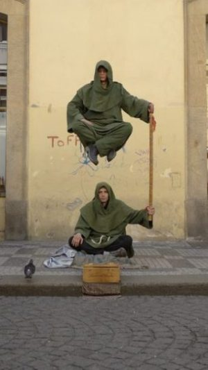 Featured Topic Image Two Cloaked Street Magicians Performing Levitation.