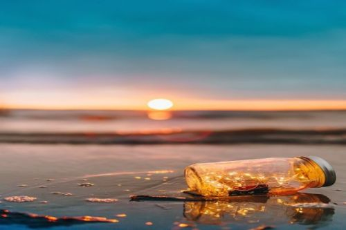 Featured Image. A Lone Jar On The Waters Edge During Sunrise/Sunset.