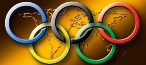 Olympic Symbolic Rings Surround/Around A World Map.