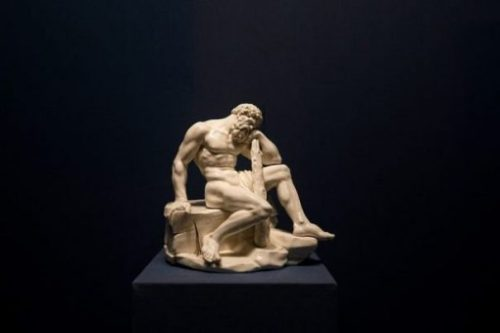 Featured Topic Statue Of Heracles/Hercules Sitting/Leaning On A Large Club Weapon.