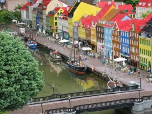 Featured Topic Image Of Legoland In Copenhagen. Highlighting A Bridge And Row Of Multi Colored Houses.