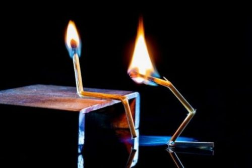 Featured Image A Bent Lit Match Sits On A Table Whilst Another Standing Looks At The Knee Bend.