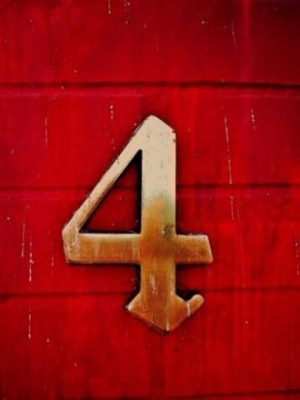 Number Four Symbol On Red Wood Wall.