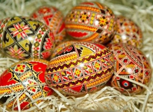 Featured Topic Image 7 Ornately Drawn/Colored Easter Motifed Eggs Lie In A Small Pile On Straw.