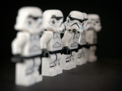Featured Image Of 5 Lego Stormtrooper Figurines In A Diagonal Row With The Middle Figure Upper Body Turned Towards The Front.