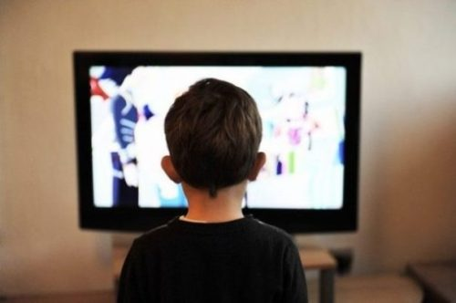 Image Of A Young Child Watching Tv.