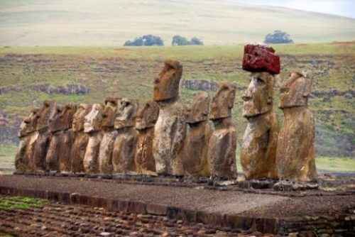 Featured Topic Image Of A Row Of Easter Island Stone Giants. Hat Is Red Stone.