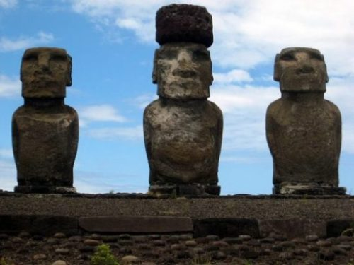 Featured Topic Image Close Up Of Three Easter Island Stone Giant Statues. Middle One Has A Stone Hat.