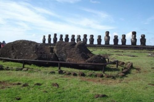 Featured Topic Image Of A Landscape View Row Of Easter Island Stone Giant Statues. Front One Lying Down.