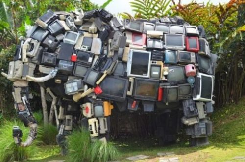Image Of An Elephant Statue Made Of Many Tv Monitors.