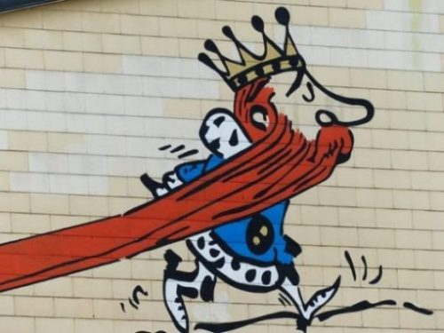 Image Of Graffiti Art Of A Long Red Bearded King Walking.