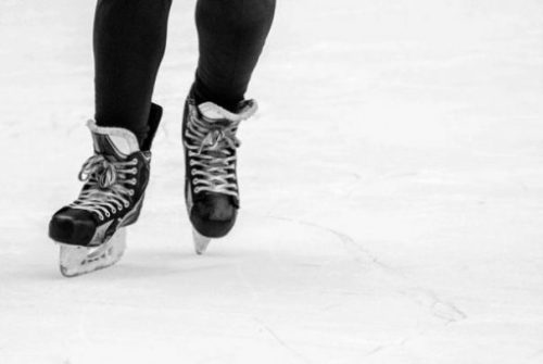 Featured Image Focusing On A Ice Skaters Lower Legs and Bladed Shoes.