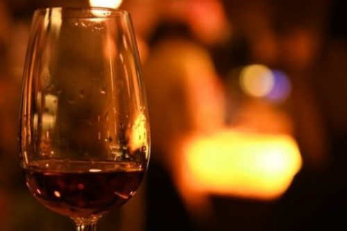 Featured Image Of A Glass Of Rum Backgrounded By Unfocused Bright Light.