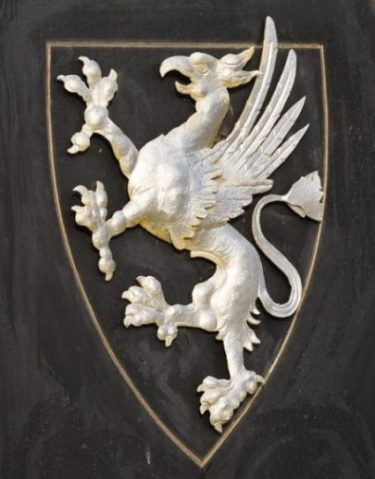 Image Of A Heraldric Rampant Griffin Badge/Shield.