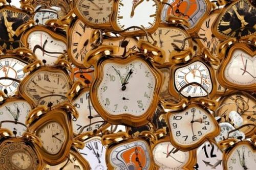 Fantasy Image Of Many Warped Old Clocks.