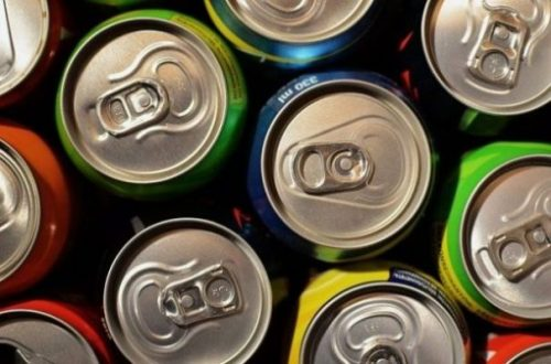 Image Of Several Rows Of Aluminum Cans Stacked Side On.