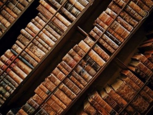 Image Diagonally Taken Of Several Classic Bookshelfs.
