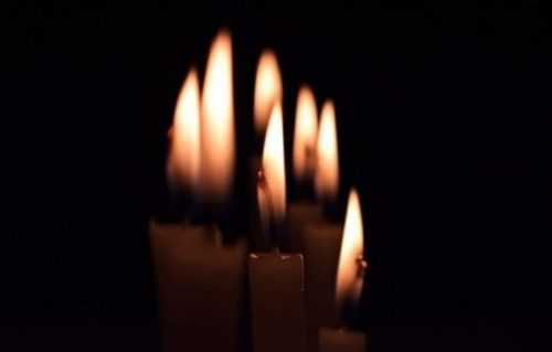Image Of Seven Candles Closely Arranged.