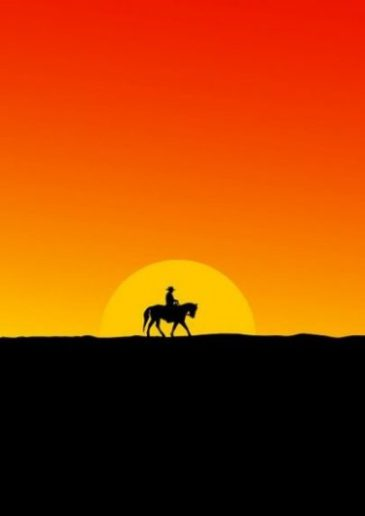 Image Of A Cowboy On Horse Sunset.