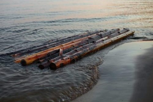 Image Of Several Raft Pieces In Shallow Waters.