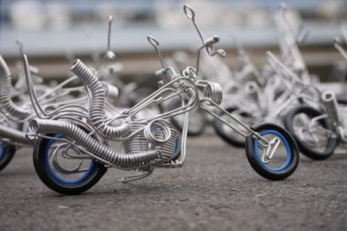 Image Of Several Toy Motorbike Sculptures.