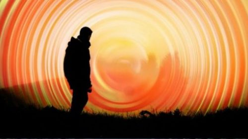 Fantasy Image Of A Shadowed Man Looking At Another Dimension.