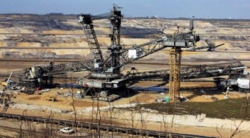 Landscape Image Of An Open Pit Mine And Equipment.