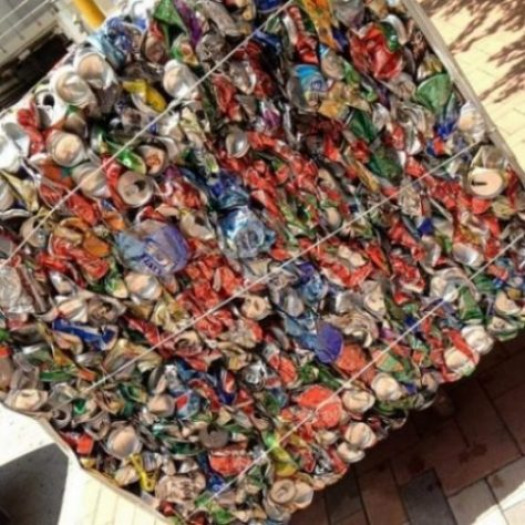 Image Of Hundreds Of Aluminium Cans Pressed Into A Large Stack.